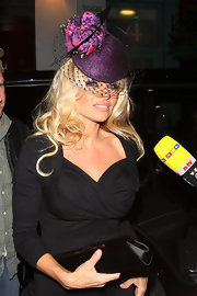 Pam Anderson is all dolled up with this purple hat... she's ready for the Kentucky Derby!