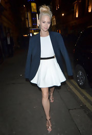 Kimberly Wyatt draped a blazer over her white fit-and-flare dress for this perfect evening look.