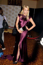Paris Hilton added glamour to her dramatic wine gown with a black velvet clutch embellished with crystals.
