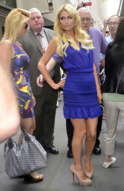 Paris elongated her gams by pairing her royal blue dress with chic nude platform pumps.