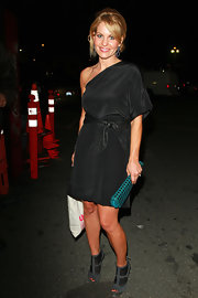 Candace added flair to her black dress with a turquoise studded clutch.