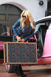 Paris lugs her own luggage—a multicolore monogrammed hardcase—out of her Barbie pink Bentley.
