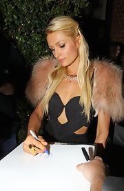 Paris Hilton wore her straight hair partially swept back while signing autographs in Beverly Hills.