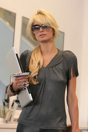 Paris stepped out of the salon sporting a loose ponytail with side-swept bangs and gradient oversize sunglasses.