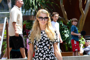 Paris Hilton, wearing a black floral dress and colored high heels, leaves the Cross Creek mall after having lunch at Café Havana with her boyfriend River Viiperi in Malibu.