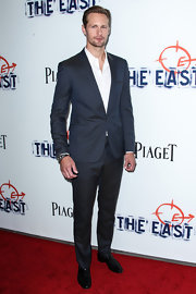 Alexander Skarsgard looked classic and cool in a single-button navy suit.