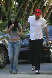 Megan Fox finished off her super casual look with a plain green baseball cap while on her way to a Lakers game.