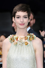 Anne Hathaway's pixie looked particularly gorgeous with the Grecian floral neckline of her dress.