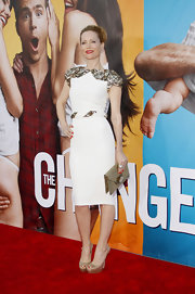 Leslie Mann glammed it up at the premiere of 'The Change up,' accenting her beaded white shift dress  with a gilded Resort 2012 envelope clutch.