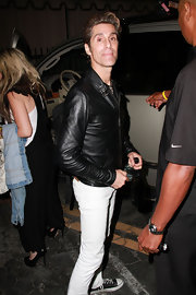 Perry hit the club sporting skinny pants with a leather jacket and a wavy, gelled hairstyle.