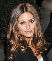 Olivia Palermo wore a shiny sheer nude pink lipstick at the Marchesa fall 2012 fashion show.