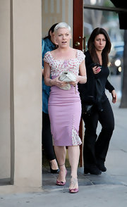Pink showed off a decidedly more feminine look in a pink floral vintage inspired dress with a pencil silhouette.