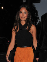 Pippa Middleton pulled her hair back with a center part and finished the look with relaxed waves.