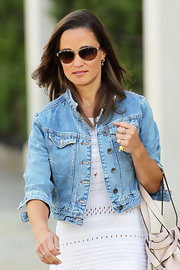 Pippa Middleton chose a classic pair of oval sunnies to protect her eyes from the summer sun as she strolled through Chelsea.