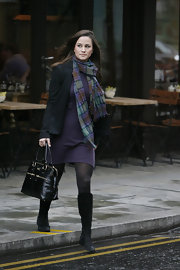 Pippa Middleton accessorized her purple sheath with a matching plaid scarf wrapped around her neck.