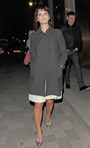 Pixie Geldof channeled '60s icon Twiggy with a short 'do and long wool coat.