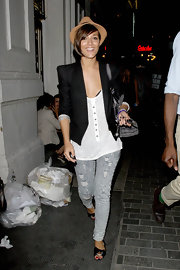 Frankie hit the club in a blazer layered over a white henley with distressed, acid-washed skinny jeans.