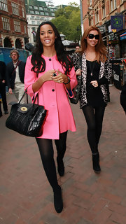 Rochelle Wiseman channeled the '60s in a mod pink swing coat.