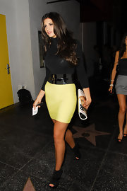 Hope showed off her neon yellow bandage skirt while hitting a party at My Studio.