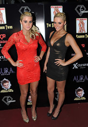 Karissa Shannon was red-hot in a lace mini dress when she hosted a lingerie party with her twin sister.