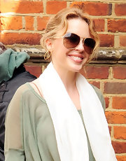 Kylie Minogue wore her wavy blond locks casually pinned up while out and about in London.
