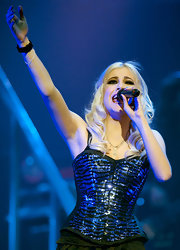 Pixie performs in a sequined animal print corset top in Gasglow.