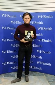 Olly Murs stepped out at the book signing of his autobiography wearing pants and a turtleneck sweater.