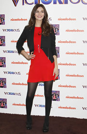 Victoria Justice wore this red knit cocktail dress with a zipper detail to promote her new album in Madrid.