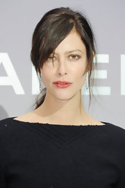Anna Mouglalis wore her hair in a low loose ponytail with long side-swept bangs while attending the Chanel fall 2012 ready-to-wear fashion show.