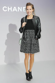 Melissa Theuriau finished off her feminine two-tone dress with a collarless leather jacket.