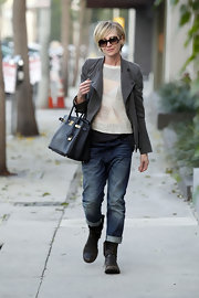 Portia gave her preppy sweater a rugged twist with faded boyfriends jeans and clunky combat boots.