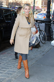 Busy Philipps looked posh in this wide collared camel wrap-coat while out in NYC.