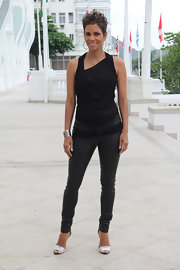 Halley Berry kept her look monochromatic with a pair of skinny leather pants and a black blouse.
