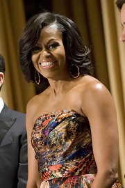 Michelle Obama attended the 2012 White House Correspondents Association Dinner wearing a pair of Aurora earrings in 18-carat rose gold with cronaline and orange sapphires.