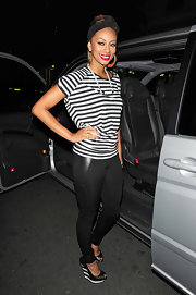 Keri Hilson stood tall in black-and-white striped platform wedges.