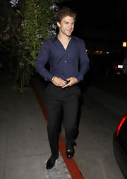 Keegan Allen stepped out at the Chateau Marmont wearing a pair of slacks and a tailored shirt.