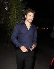 Keegan Allen looked sharp in a polished outfit consisting of a pair of slacks and a button-down shirt.