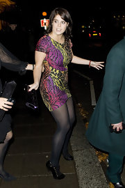 Princess Eugenie took a walk on the wild side in an animal print cocktail dress. She paired her look with black tights and pumps.