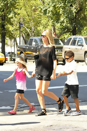 Heidi Klum runs errands in New York in a sheer black sweater paired with black gladiator sandals.