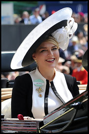 Caroline topped off her black-and-white look with this wide-brimmed topper that featured a white rosebud detail.