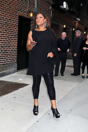 "The always fabulous Queen Latifah completed her all black ensemble with a pair of peep-toed, cutout ""Kim"" ankle boots."