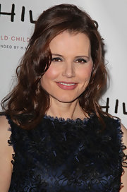 Geena Davis wore her hair in a glamorous half up style featuring long tousled waves at the World Childhood Foundation USA Gala.