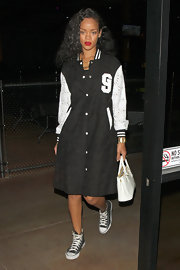 Rihanna rocked a retro schoolyard look with a ladylike tote as the perfect grown up finish.