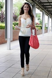 Rachael arrives for her interview at Nova radio station sportin this pink leather Chanel purse.