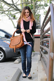 Looking casual but chic, Rachel Bilson sported a carmel colored tote with some interesting embellishments on the front.