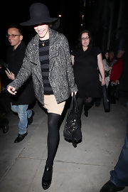 Rachel wears a wool herringbone coat over a striped sweater while out for a show in Hollywood.