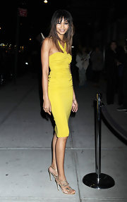 Chanel Iman wore a yellow knit dress to the Obama fashion fundraiser.
