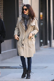 Rachel Weisz trekked through NYC in chocolate leather ankle boots with tasseled zippers. A classic trench completes the timeless look.