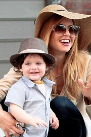 Looking stylish in a pint-sized brown fedora, Skyler happily posed for fans with Mom Rachel Zoe in NYC.