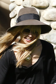 Rachel Zoe chose a wide floppy hat for her signature '70s-inspired look while out with her family.